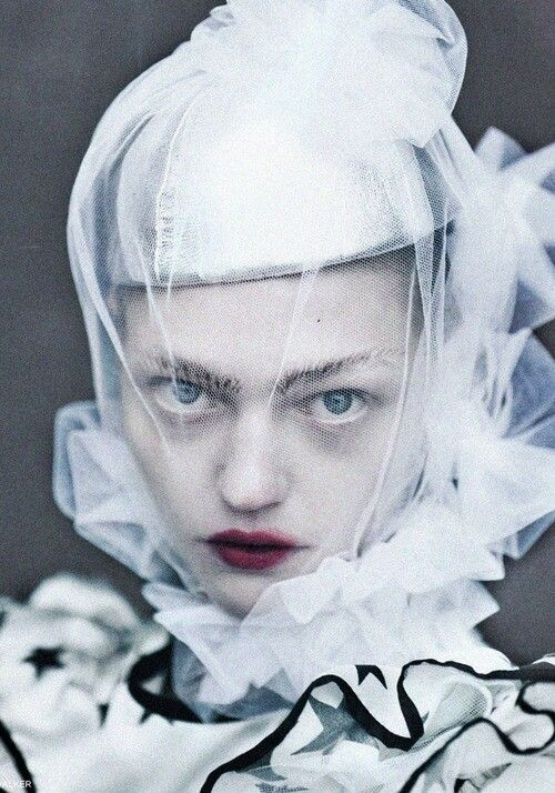 Sasha Pivovarova wears a tulle veil and serves a haunting glare in the editorial 'White Nights' shot by Tim Walker for Vogue UK