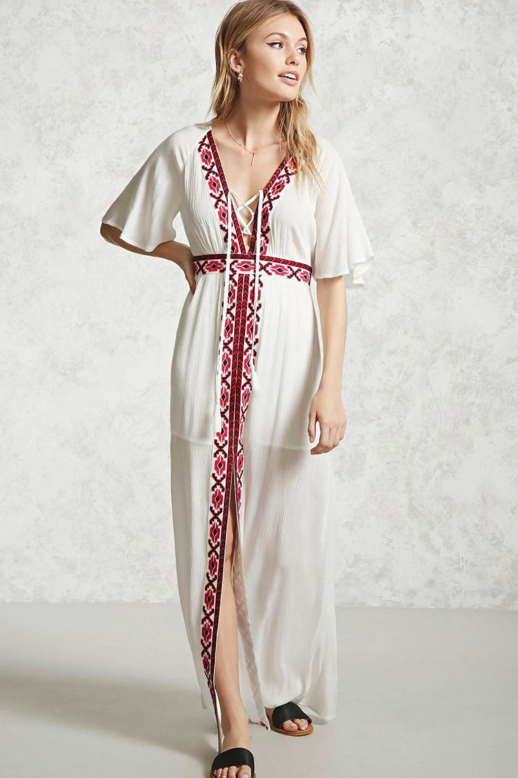 A crinkled woven maxi dress featuring front tribal inspired