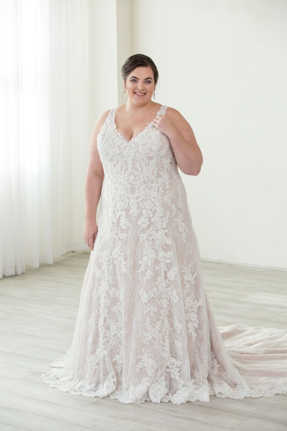 c9ee5691a9980 Plus Size wedding dress - A-line Justin Alexander wedding gown. Portland,  OR bridal boutique featuring gowns in all shapes and sizes.