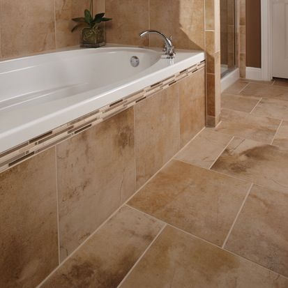 Use Large Tiles For A Tub Face And A Decorative Border Large Shower Tile Tile Tub Surround Bathroom Tile Designs