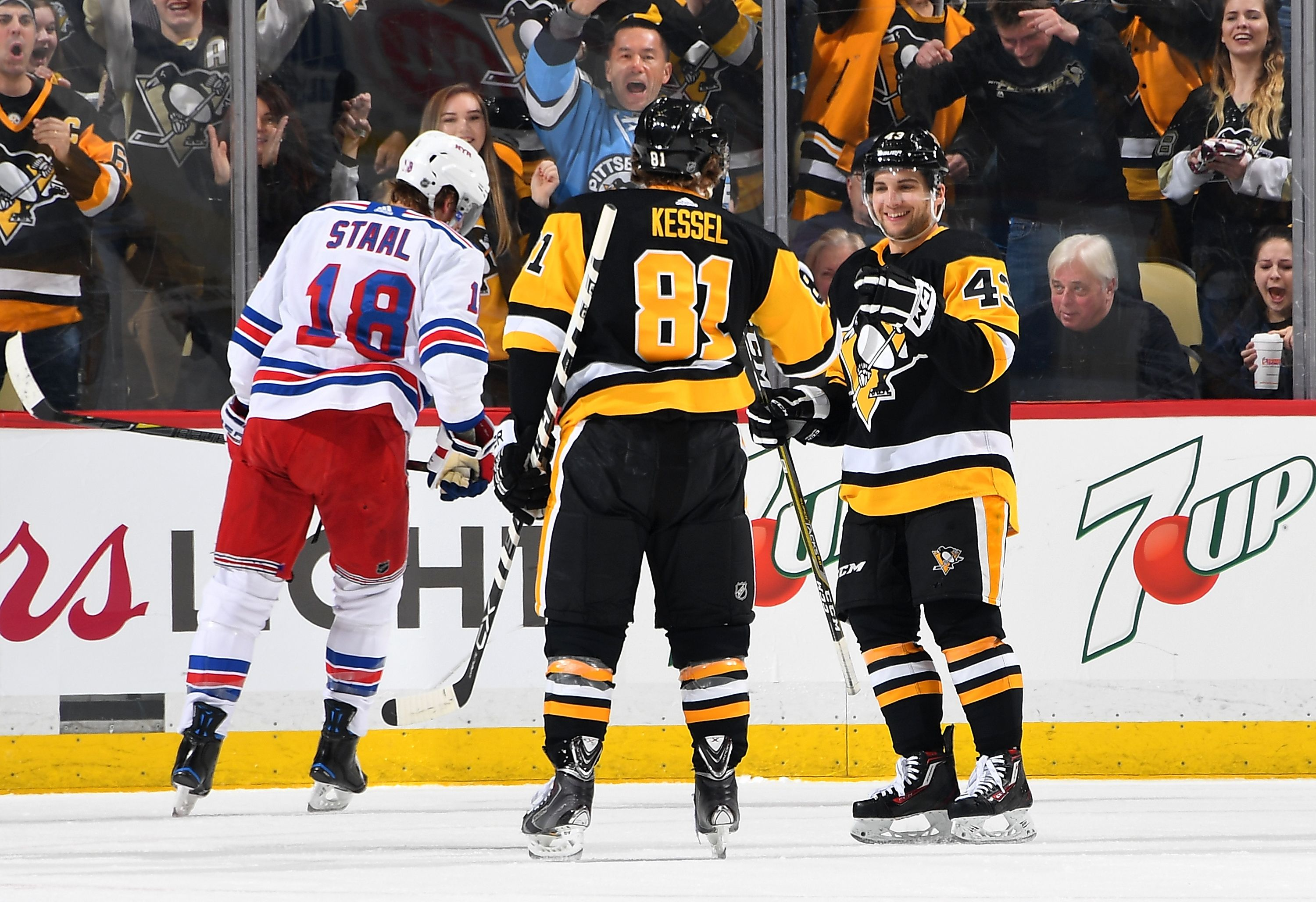 Officials separate Pittsburgh Penguins Arron Asham and New York Rangers Stu  Bickel in the second period