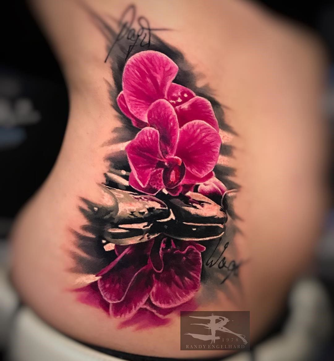 d62a74ea84675 Pretty pink orchids, realism piece on girl's side by Randy Engelhard,  artist and owner of Heaven of Colours tattoo studio in Zwickau, Germany.