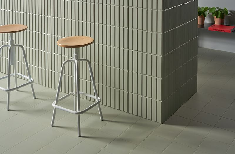 A Series Of White Bodied Wall Tile Comprised Of Opaque Geometric And Three Dimensional Surfaces Coffee Shop Interior Design Wall Tiles Modern Floor Tiles