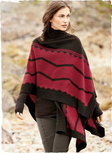 Tribal graphics inspired by a traditional chief's blanket make a striking statement in vibrant tomato and walnut. A gorgeous layering piece, knit of sublimely soft, woolen-spun royal alpaca.