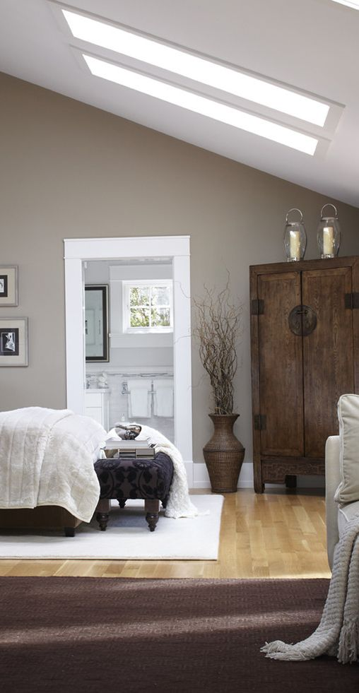 This spacious and welcoming bedroom perfectly mixes modern function with rustic charm!