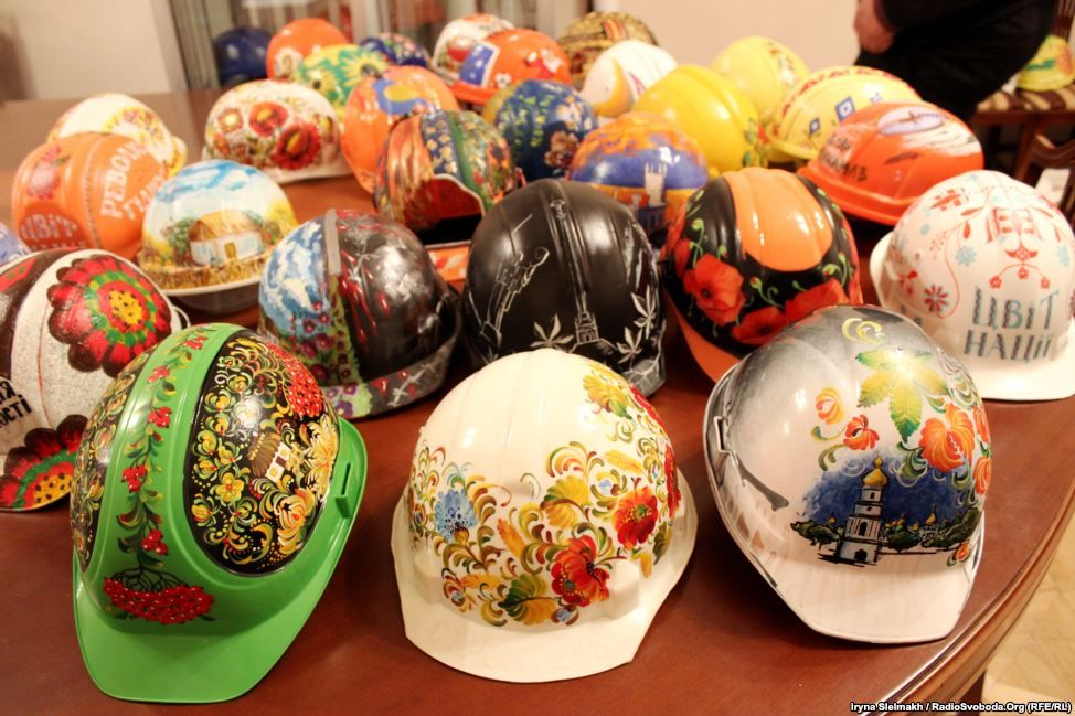 """The Painted Helmets of Ukraine's Protest Movement - """"As mass antigovernment protests continue in Kyiv, activists have found a new medium for their message. Artists aligned with the Euromaidan demonstrations are exhibiting more than 100 painted helmets of the type worn by protesters to protect themselves during clashes with police. The decorations range from religious icons and nationalist slogans to the folk art style know as petrykivka.""""  (Photos by Iryna Stelmakh, RFE/RL's Ukrainian…"""