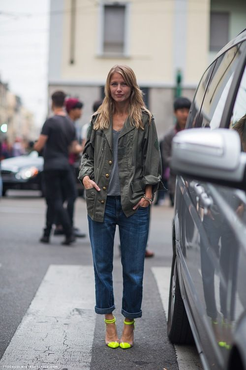 Holli Rogers in a olive army jacket, grey t-shirt, boyfriend jeans and Louboutin fluor heels.