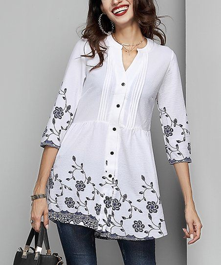 Flatter your frame as you enliven your look with this flowing top ...