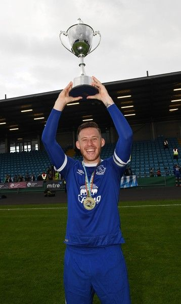 Everton captain Gethin Jones celebrates with the trophy after the Super Cup NI under 21 final at Ballymena Showgrounds on July 23, 2016 in Ballymena, Northern Ireland.