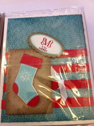 "Stamp Set: stitched stockings (123784), occasions alphabet (123598)    Cardstock: whisper white (100730), Marina Mist (119682), real red (102482), crumb cake (120953)    Ink: Marina Mist (119668), real red (103133)    accessories: snowburst and polka dot emboss folders (124096, 117335) 1/4"" whisper white gros grain ribbon (109025), stocking punch (124095), oval punch (119855) and scallop oval punch (119856)"