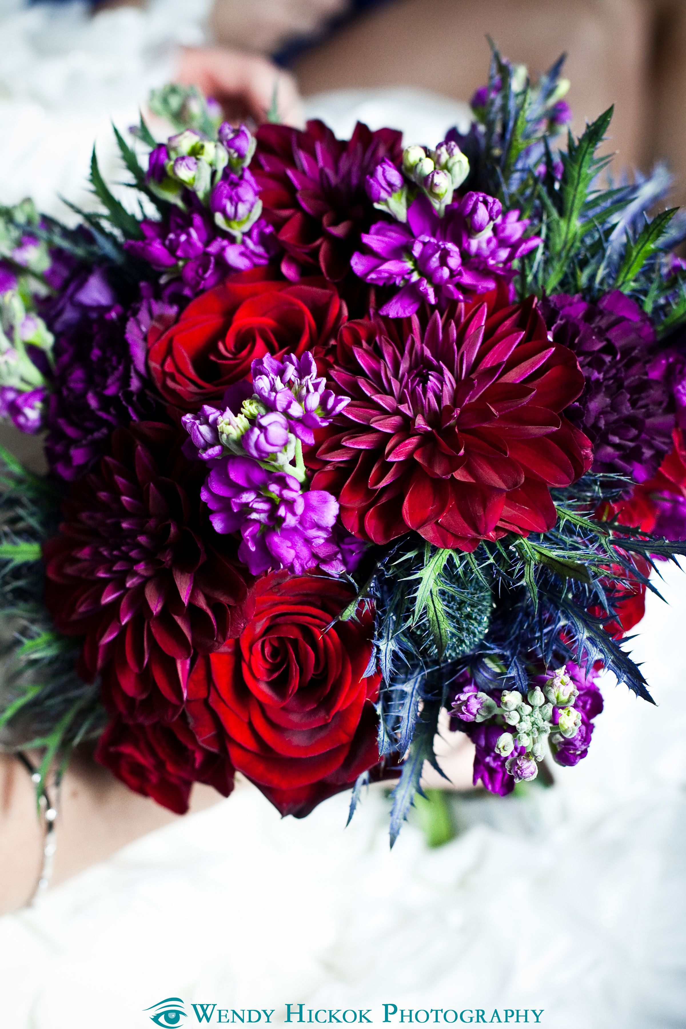 Jewel tone bouquet wedding floral center pieces in