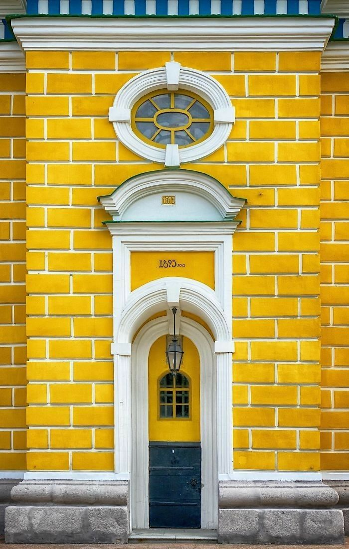 Yellow Brick Surrounds Door Unique Doors Beautiful Doors Accidental Wes Anderson