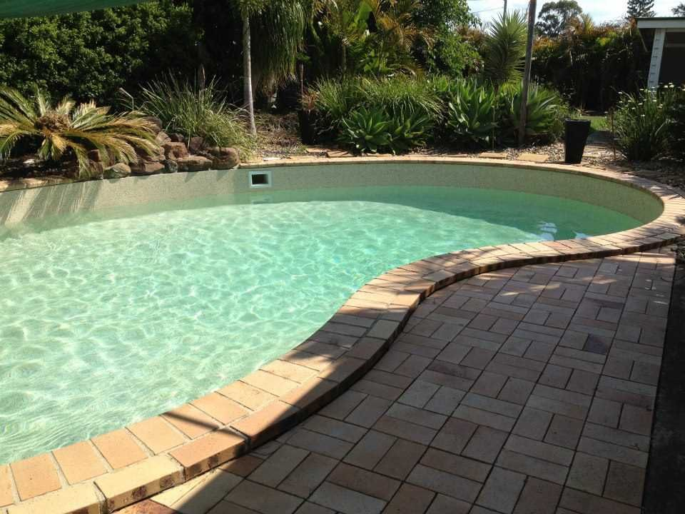 Aqualux Pool Finish in 'Coral Sand' gives this pool the