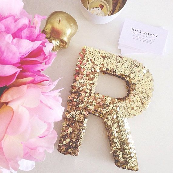 gold or silver sequin letter