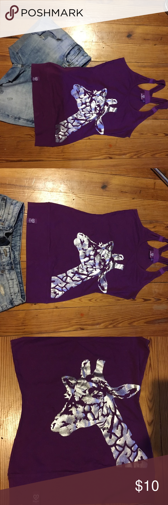 Purple tank with silver giraffe image Purple womens tank by LRG. Wide bottom waistband with LRG logo on left hip. Silver foil giraffe logo. Straps have ruched accent details. Size small. Back is plain solid purple. Lrg Tops Tank Tops