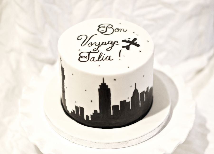 Bon Voyage Cake With White Fondant And Hand Painted Lettering And