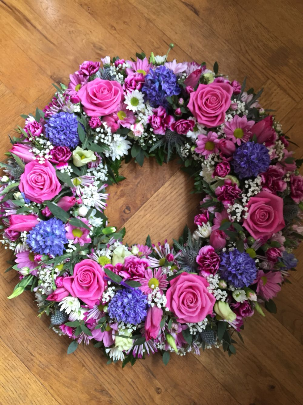 Rich pink blue and purple wreath funeral tribute in mixed flowers rich pink blue and purple wreath funeral tribute in mixed flowers dhlflorist Choice Image
