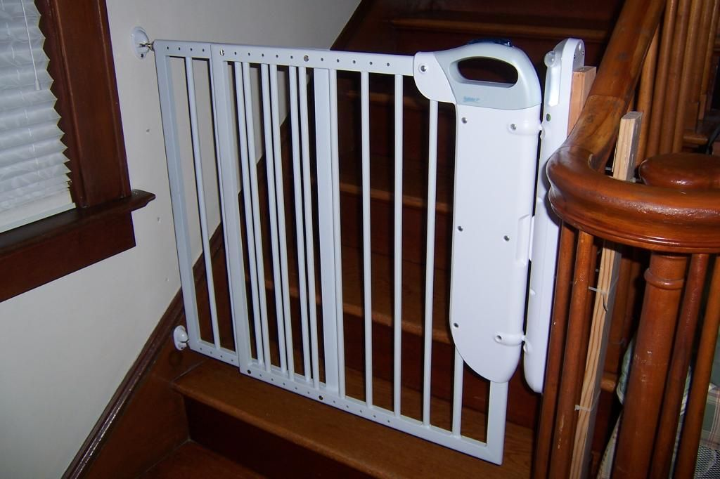 Superior Vintage Wooden Staircase Design With Wooden Railing And White Wall And  White Metal Baby Gate For Top Stairs