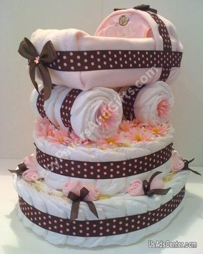 Diaper cake, I would use blue and nursery colors- love this one, you could fill the top part with small gifts