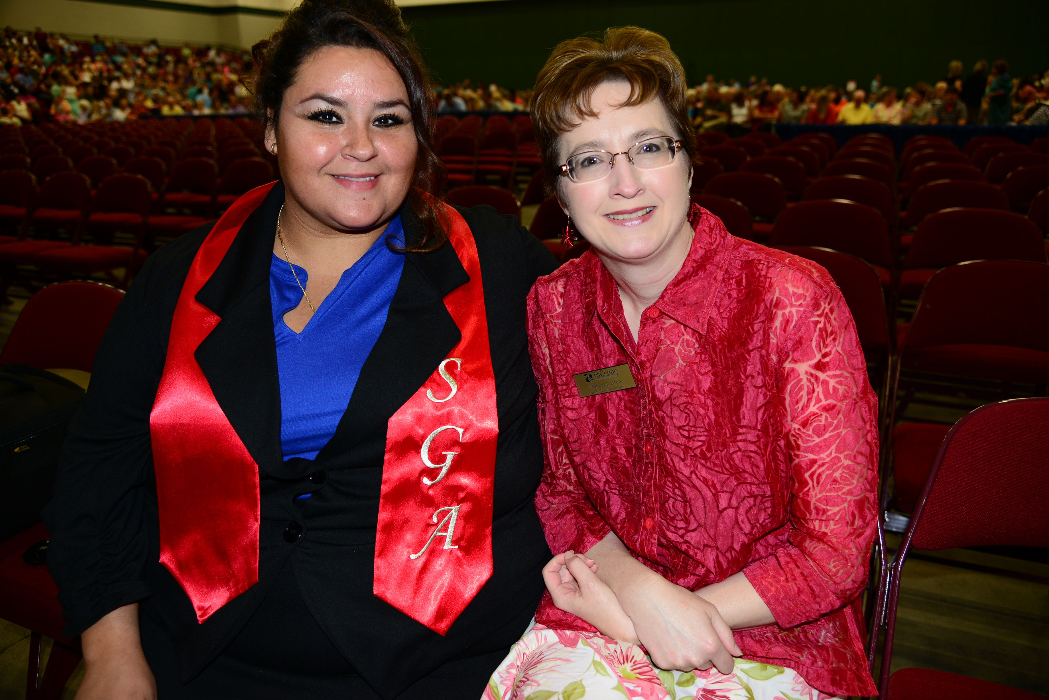 SGA President Melina Rodelo and Alumni Relations Director Mary Johnston cheer on grads before the ceremony.