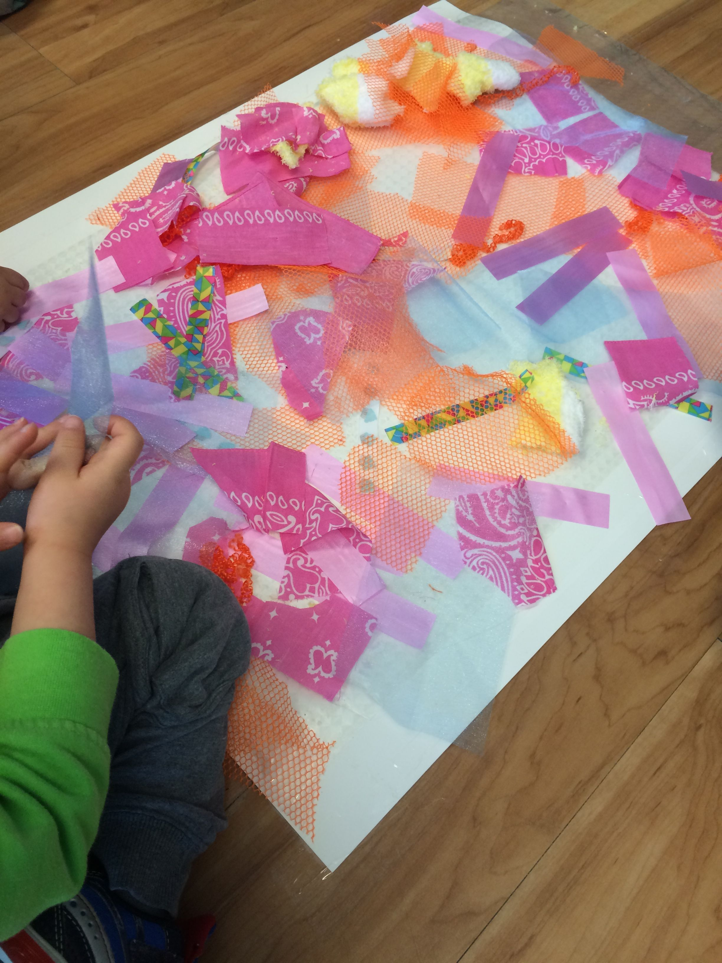 Adhesive paper with materials to create a collage (toddler).