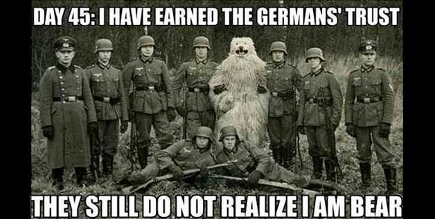 Man in a bear costume standing with Nazi soldiers (via Imgur)
