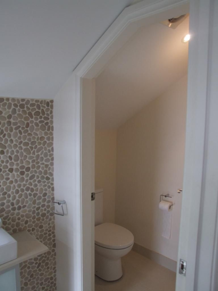 Bathrooms sloped ceiling bca compliance small attic for Ideas for a small toilet