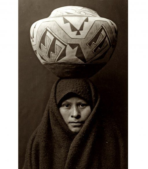 A Zuni Native-American girl with a pottery jar. Photograph by Edward S. Curtis, c. 1903.