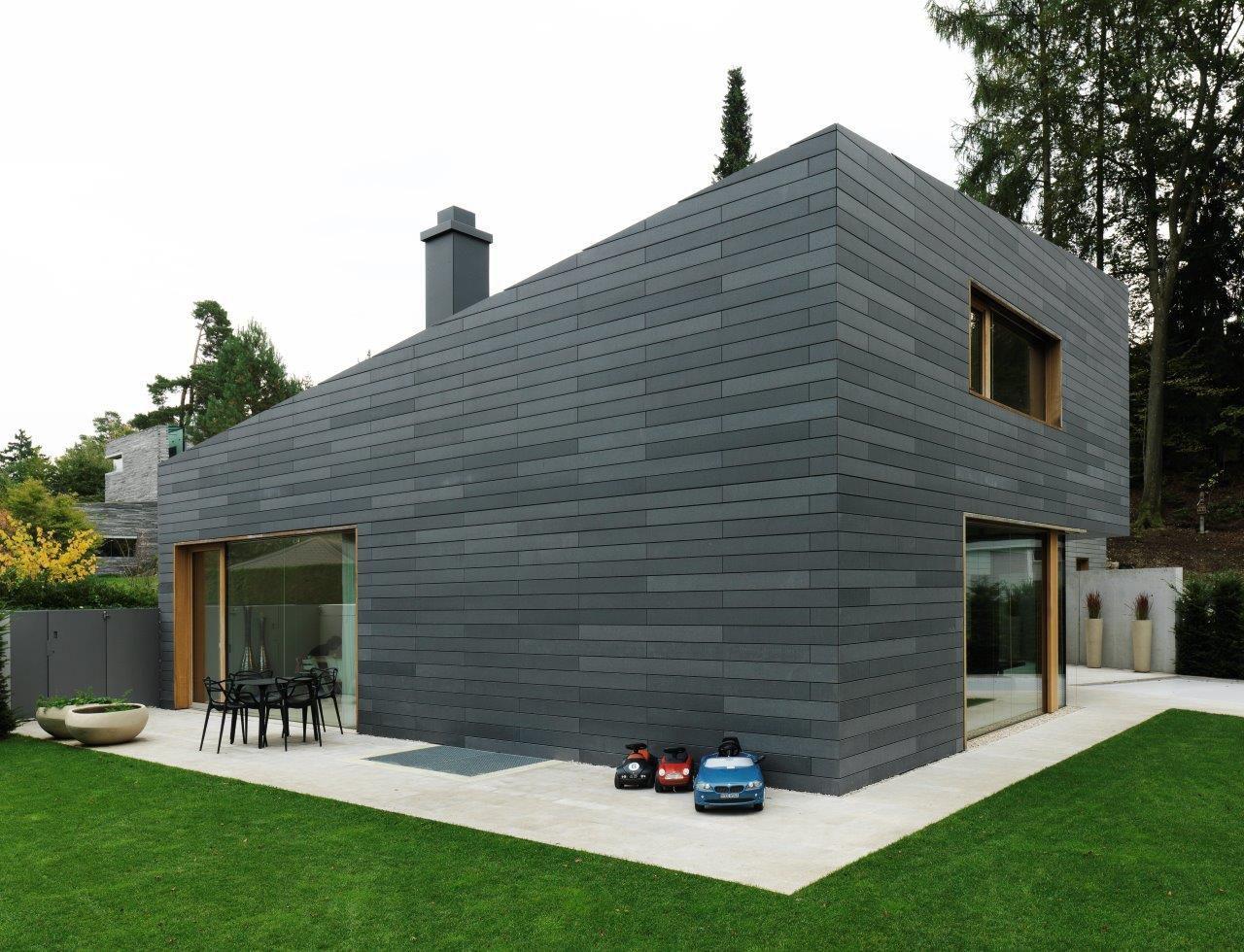 Fassadenverkleidung aus beton gestrichen lamellen for Smart haus wohncontainer