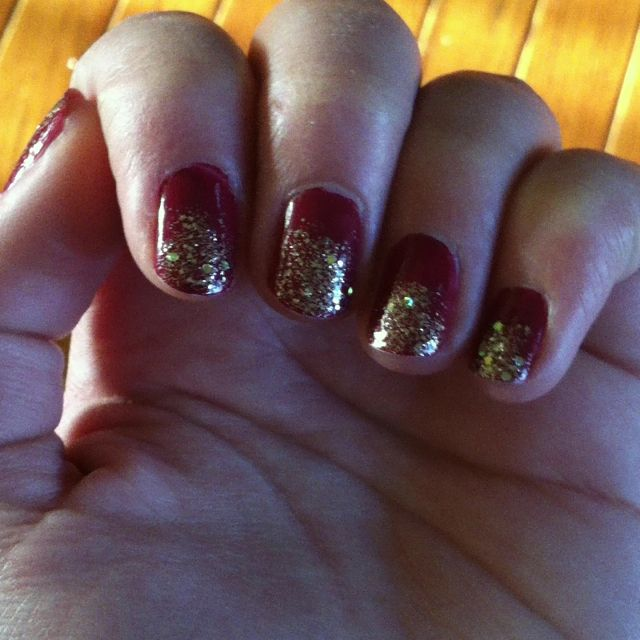 Gold glitter and cranberry red nails