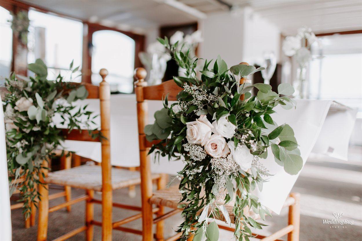 The Wedding Of Karalee Smith And Steve Gustke Bride Groom Chairs Wedding Flowers Floral Wedding