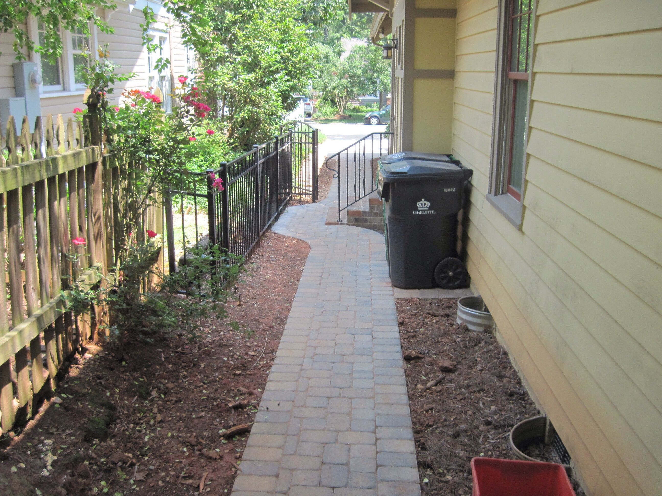 paver walkway to get from driveway to back patio with a park