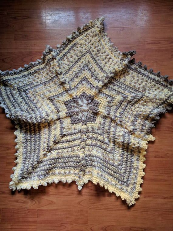 Check out this item in my Etsy shop https://www.etsy.com/listing/265932254/crocheted-baby-star-blanket