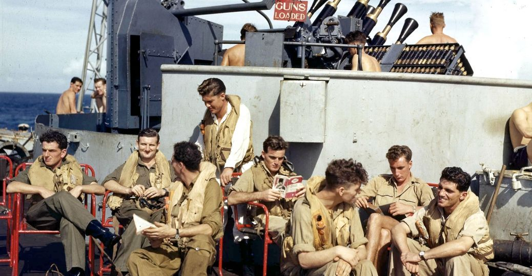 British aircraft carrier pilots relax on deck near Indonesia while waiting for the next strike. December 1944.
