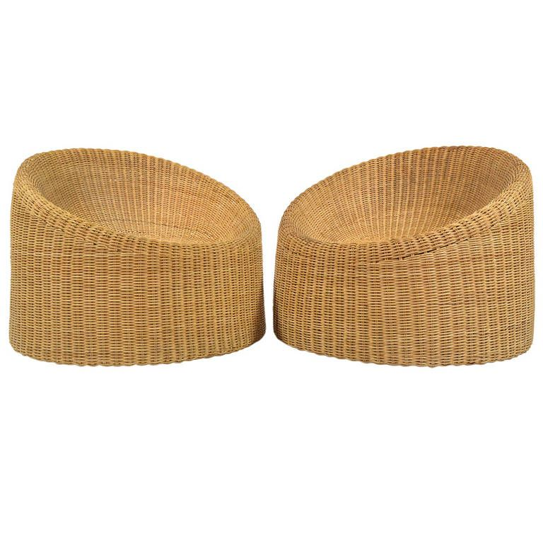 Pair of Wicker Lounge Chairs by Eero Aarnio | From a unique collection of antique and modern lounge chairs at https://www.1stdibs.com/furniture/seating/lounge-chairs/