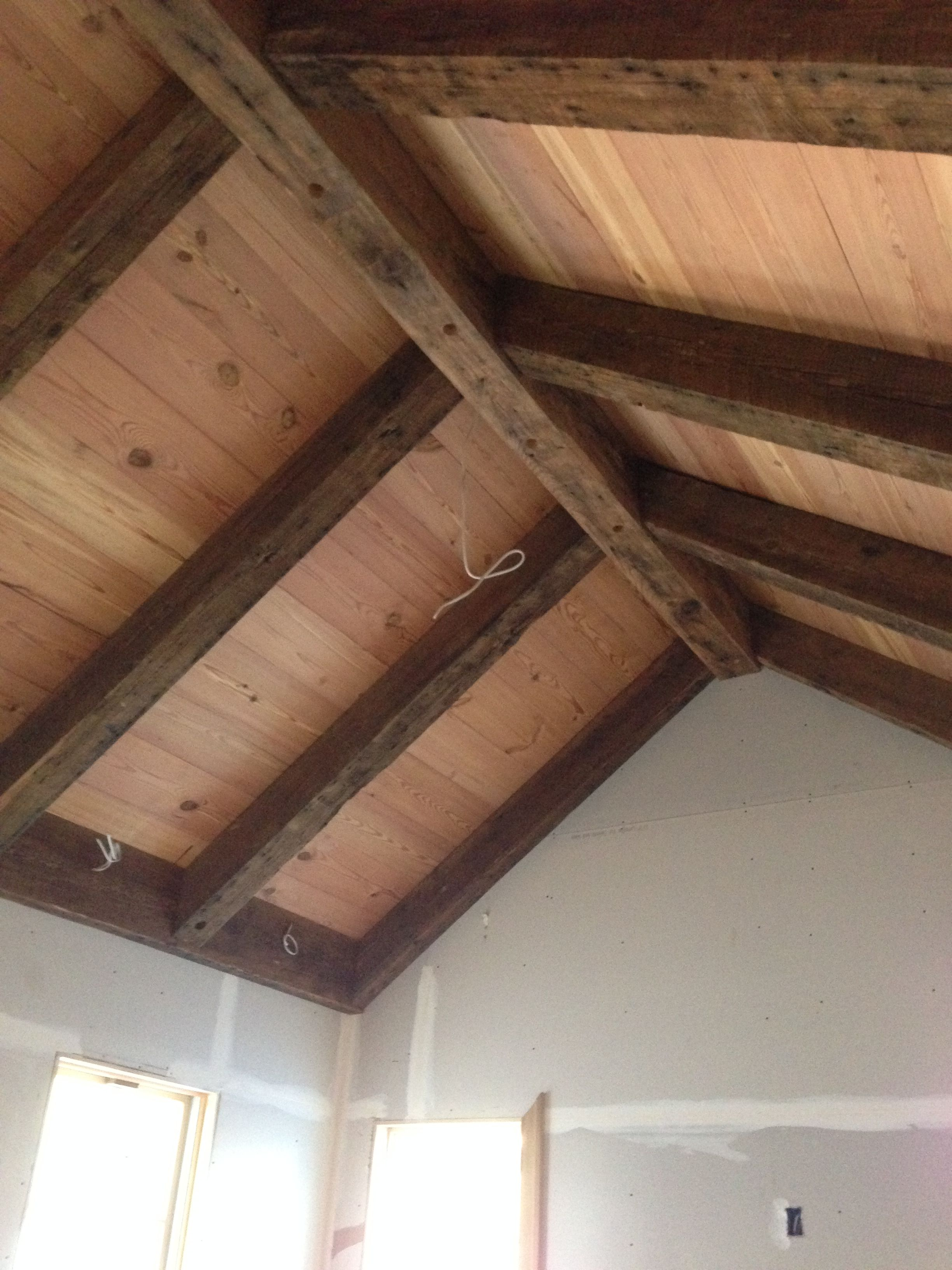 The ceiling material is 1x10 antique heart pine that was cut