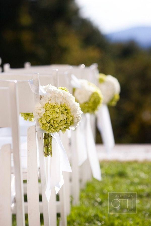 green and white hydrangea bouquets for aisle decor