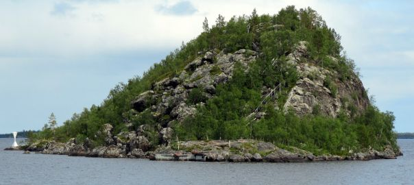 Finnish Lapland, INARI, Ukonsaari island -  The island is SEITA, the old Sami place of worship, the slopes of the cavities have been imported into the gift, game animals, sheep and goat bones, especially of deer antlers.