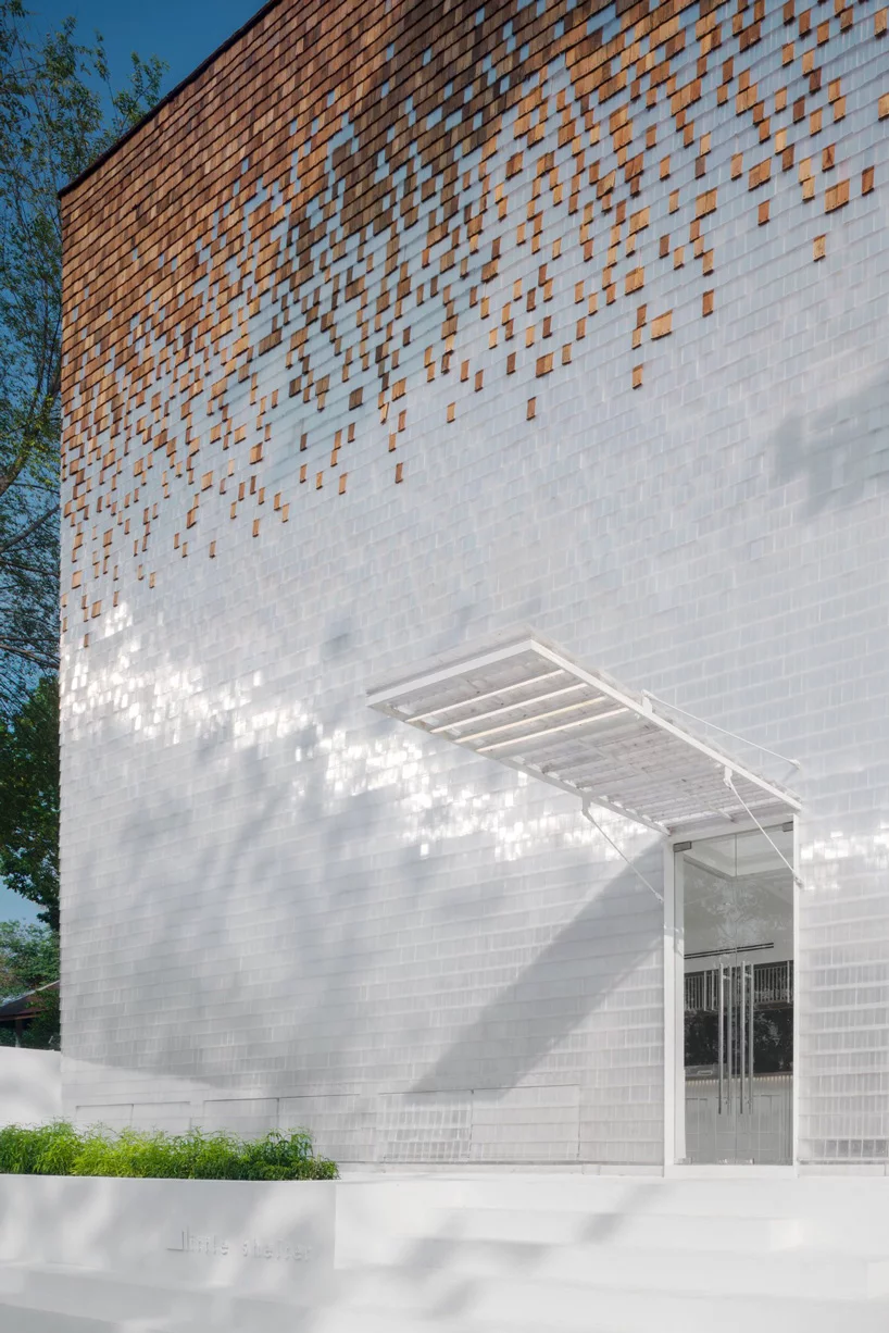 department of architecture adds shimmering façade to little shelter hotel in thailand