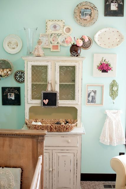 This collection of antique plates and photographs is the perfect touch in this girl's nursery.