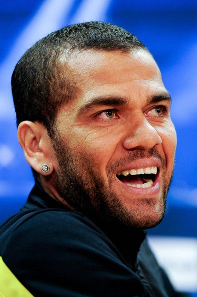 Dani Alves of FC Barcelona faces the media during a press conference ahead the…