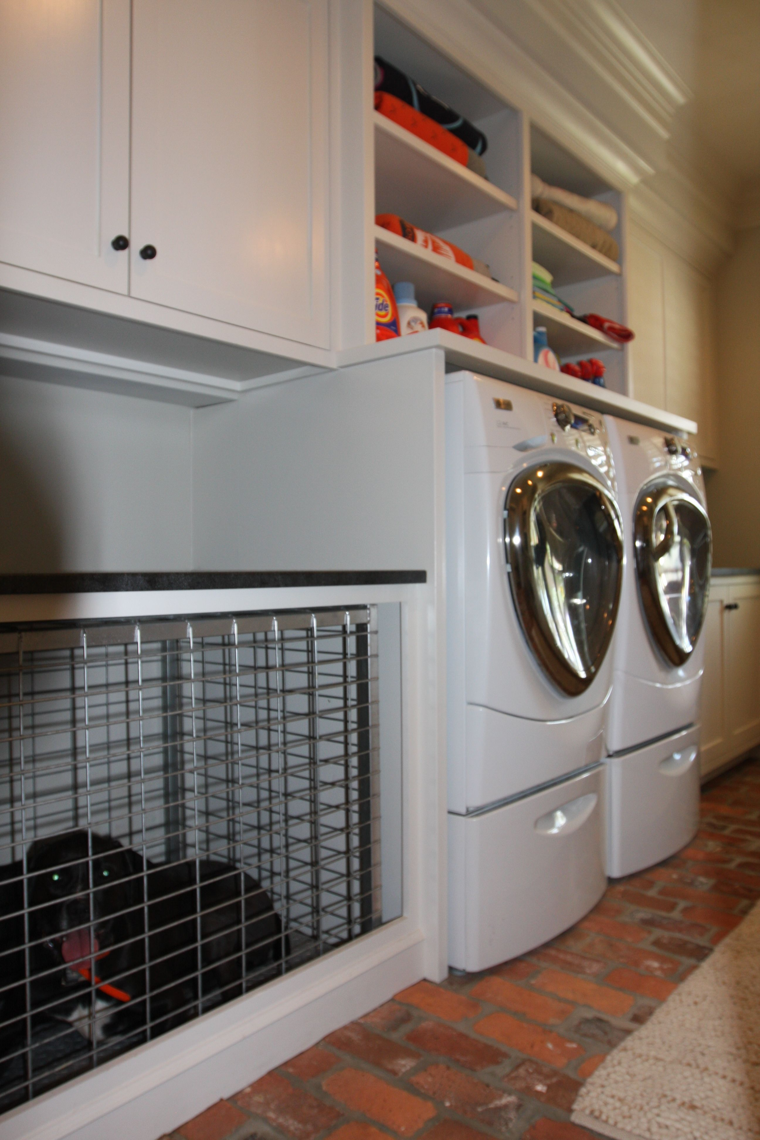 Built In Dog Cage In Laundry Room With Brick Flooring And