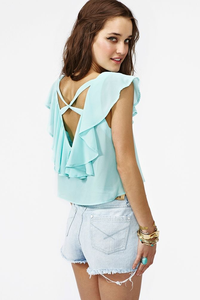 it's mint, ruffly and has a cut out. clearly made for me.