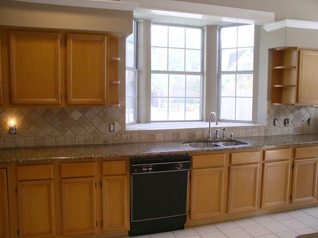 Best Brown Granite Counters With Light Wood Cabinets Rim Rd 400 x 300