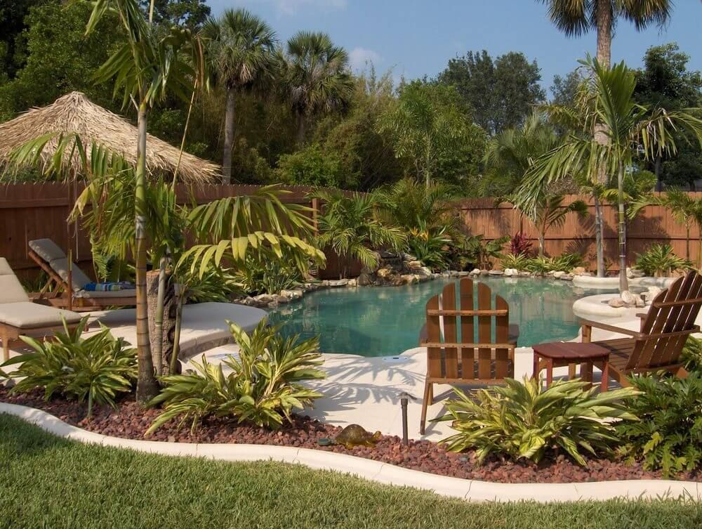 Superieur Tropical Backyard Pool With Rock Garden, Patio And Palm Trees.
