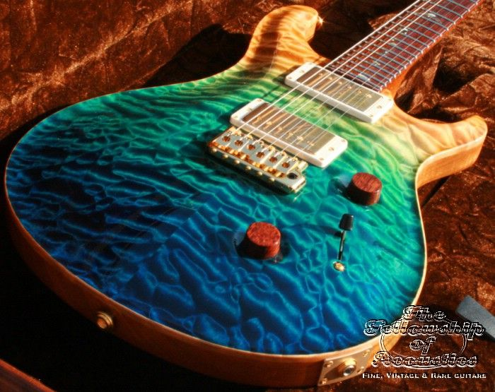 Beautiful guitar!!!!   Pearl Dove Inlays  and Im geussing its a Maple Wood Neck. This is a PRS (paul reed smith) gorgeous guitar!!!!