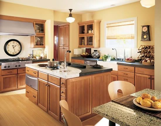 yellow kitchen walls with oak cabinets, Flooring: red oak natural (?) w/ yellow walls and medium
