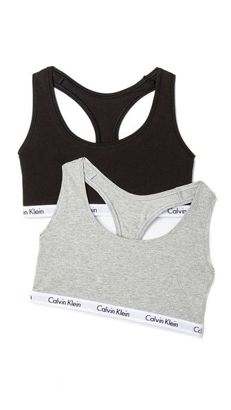 4f1c0777f4493 Need gift ideas  Check out our Holiday Gift Guide! A set of two racer-back Calvin  Klein Underwear bralettes. Logo-print elastic band.