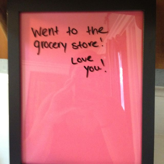 Home made dry erase message board! Picture frame with color stock paper inside! Perfect :)