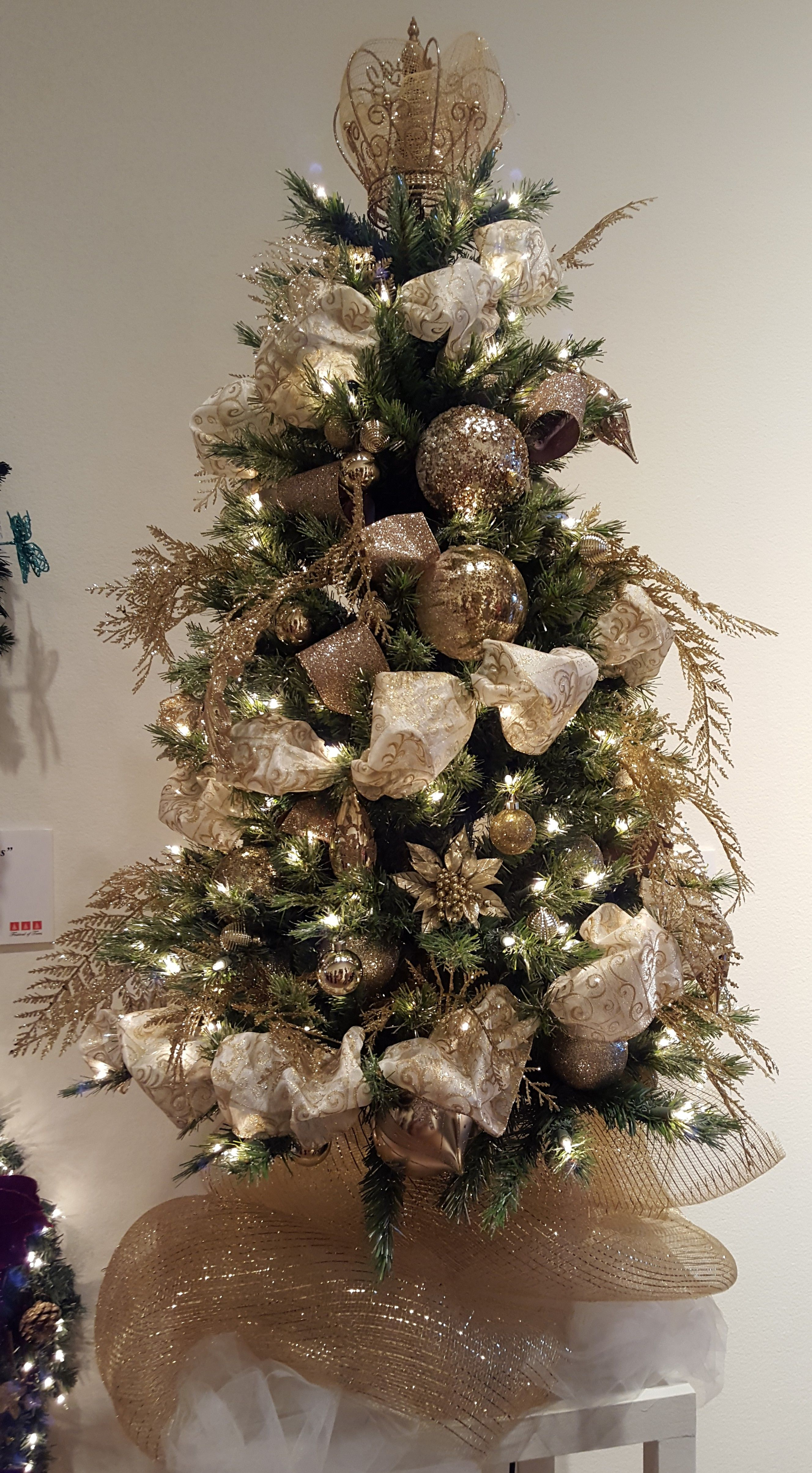 The Topper On This Tree Is A Crown Gold Christmas Tree